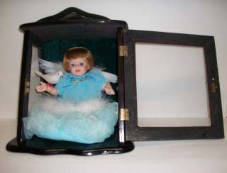 ASHLEY BELL BABY DOLL IN WOOD CASE COLLECTABLE HOLDING A BIRD WITH
