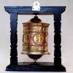 TIBETAN WALL HANGING PRAYER WHEEL on carved wood stand