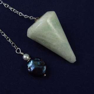 You are considering a beautiful crystal pendulum with an organza